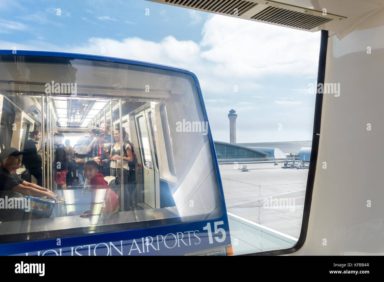 Houston George Bush Intercontinental Airport people mover train and control tower at international airport Houston - Stock Image