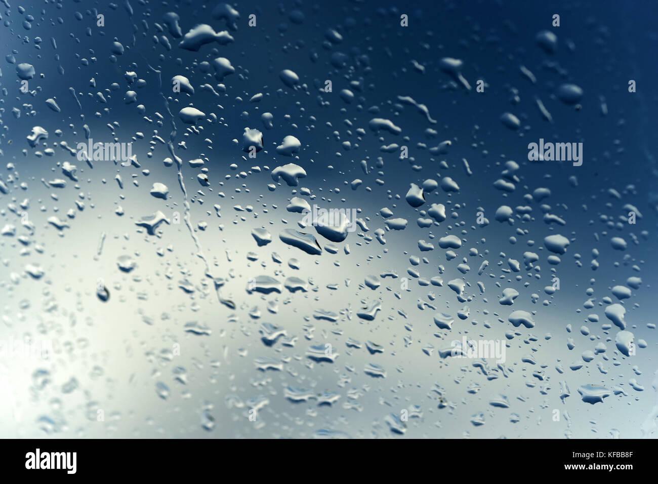 Rain water drops on windows glass - Stock Image