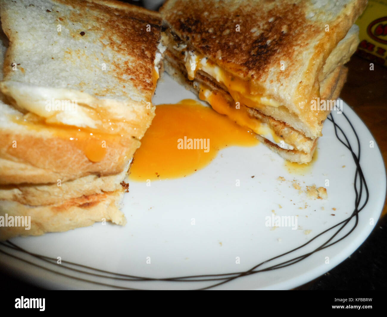 Toasted fried egg sandwich - Stock Image
