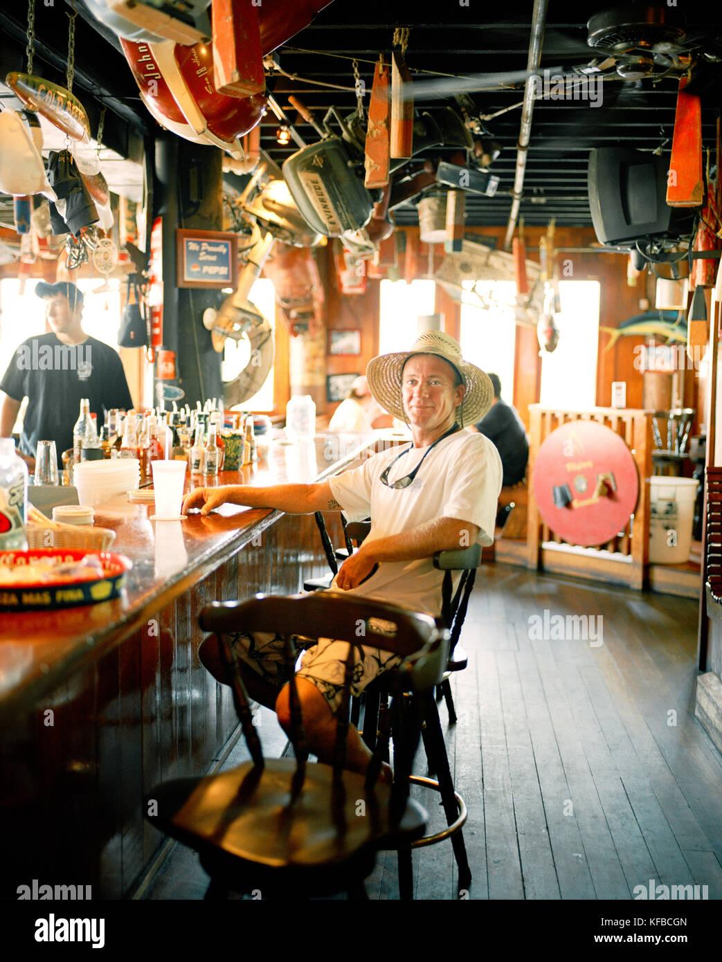 Usa Florida Fishing Boat Captain Sitting At Bar Aj S
