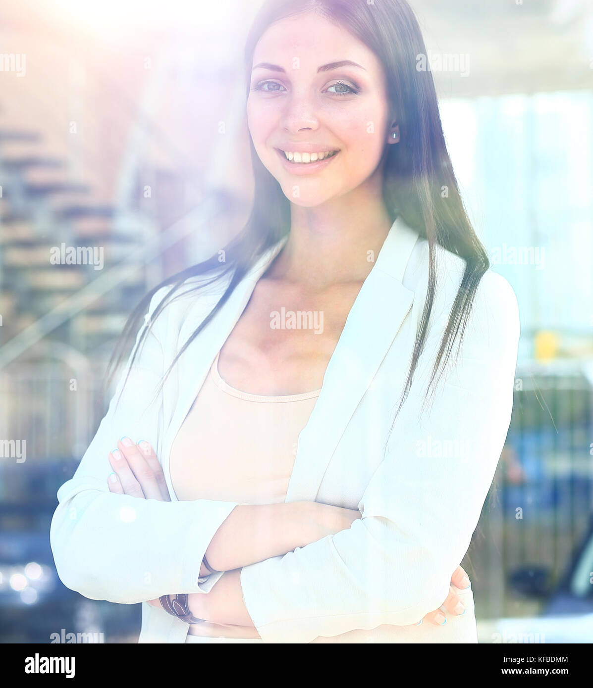 business woman looking thtough window in the office - Stock Image