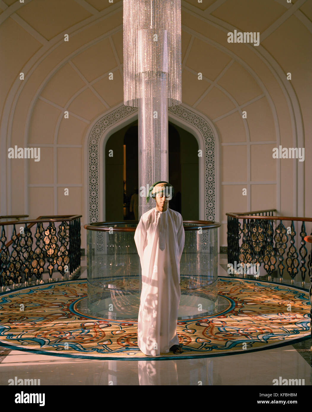 OMAN, Muscat, Barr Al Jissah Resort and Spa, Bellboy standing in hotel, portrait - Stock Image