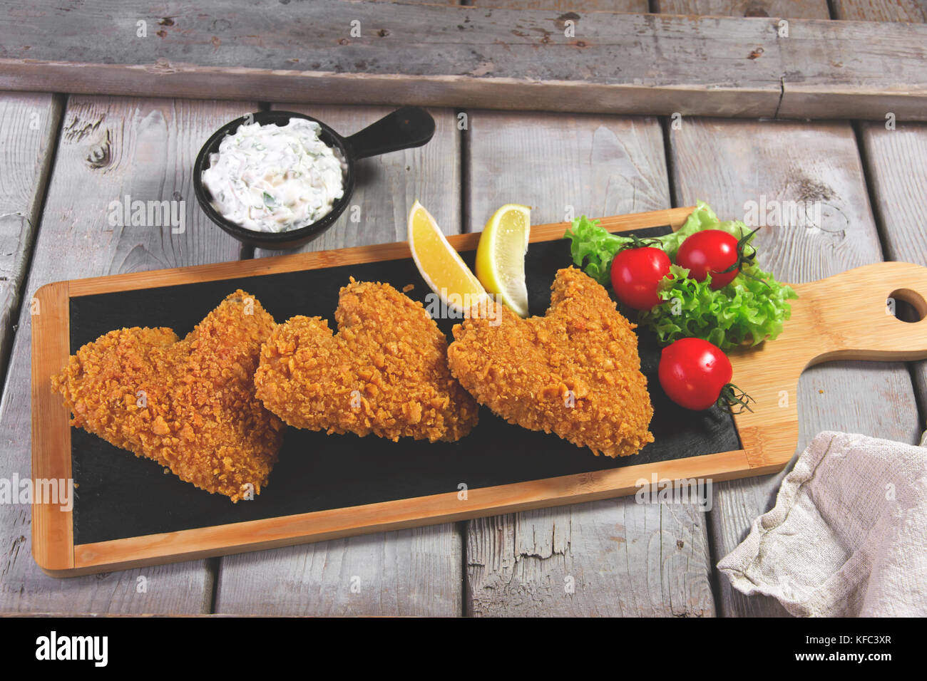 fried chicken wings breaded crispy with sauce - Stock Image