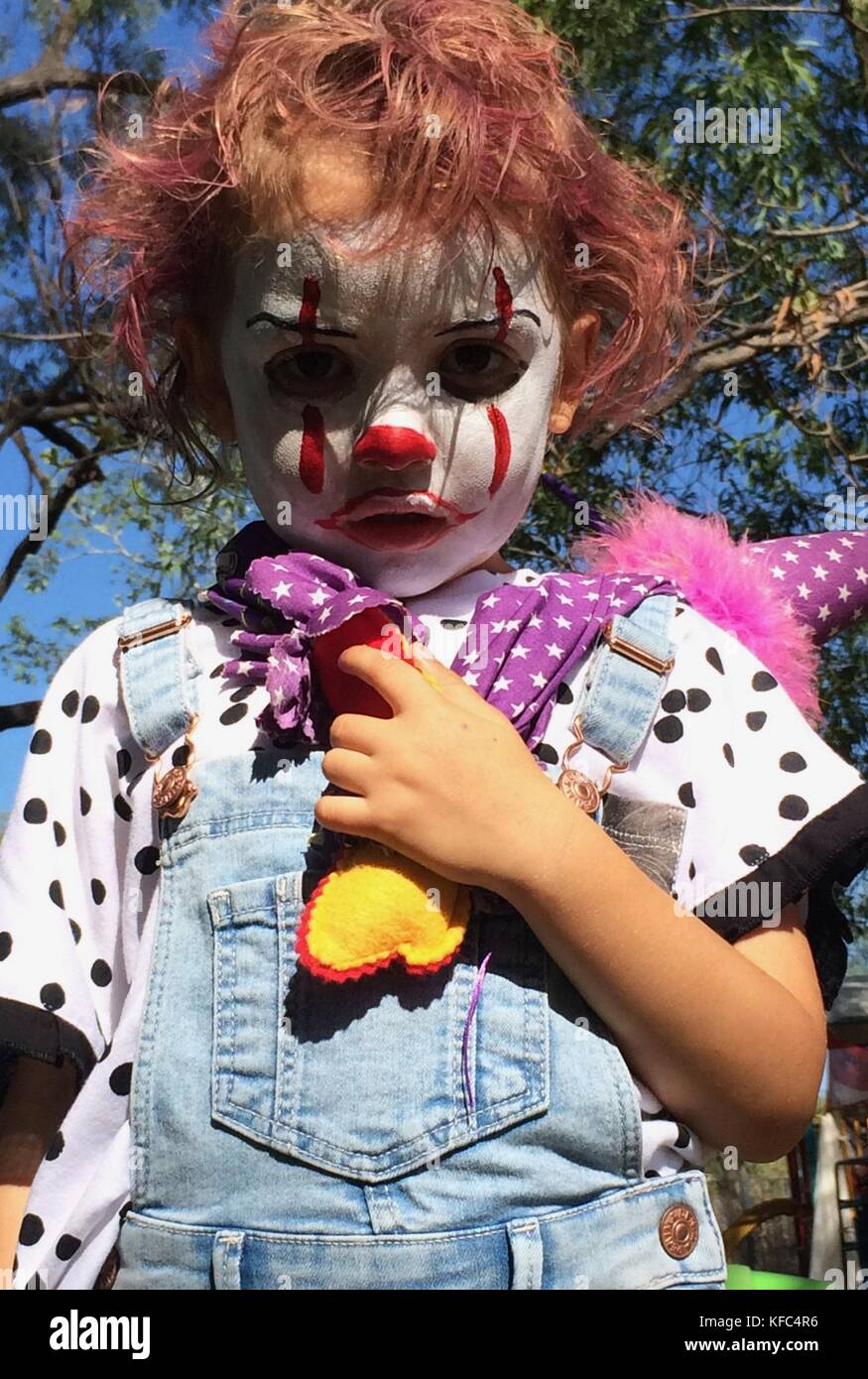 A child with makeup and dress inspired by the film It, in preparation for a kindergarten Halloween Party, Queensland, - Stock Image