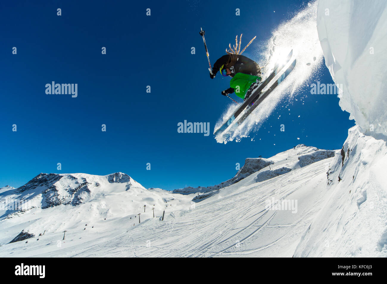 freeride skier jumping off the cliff - Stock Image
