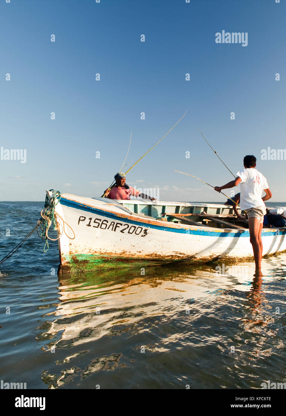 MAURITIUS, fishermen pull their rods out of a boat after a day of fishing, Bel Ombre, Indian Ocean - Stock Image
