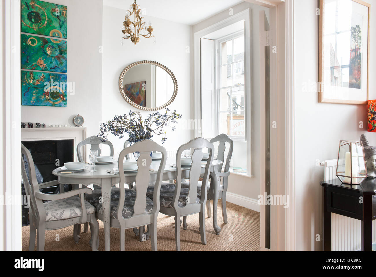 A contemporary / traditionally styled domestic dining room, showing a dining table and other furniture in a UK home. Stock Photo