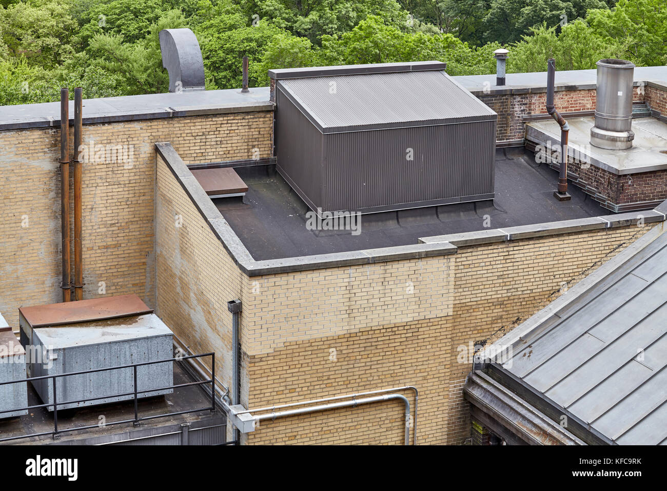Ventilation and air conditioning infrastructure on apartment building rooftop. - Stock Image