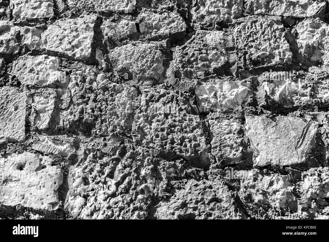Wall made of stones of different shapes and sizes. Background - Stock Image