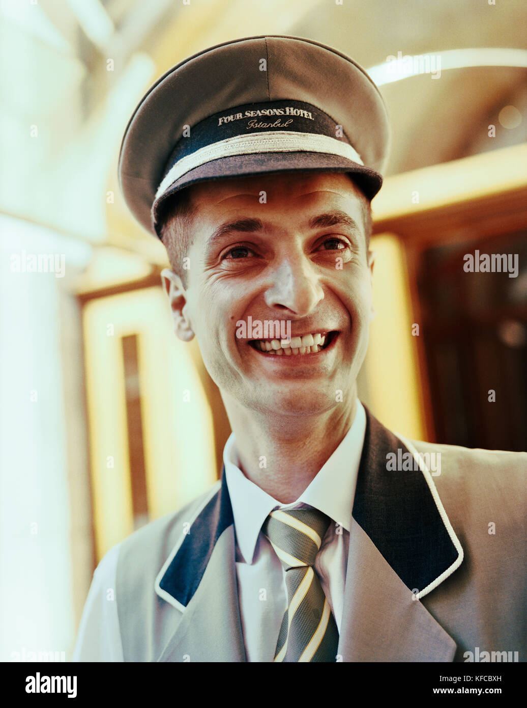 TURKEY, Istanbul, close-up of a smiling mid adult bellboy at the Four Seasons Hotel. - Stock Image