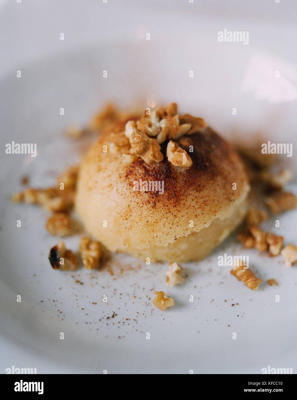 TURKEY, Istanbul, close-up of Semolina Halva dessert at Tugra Restaurant. - Stock Image