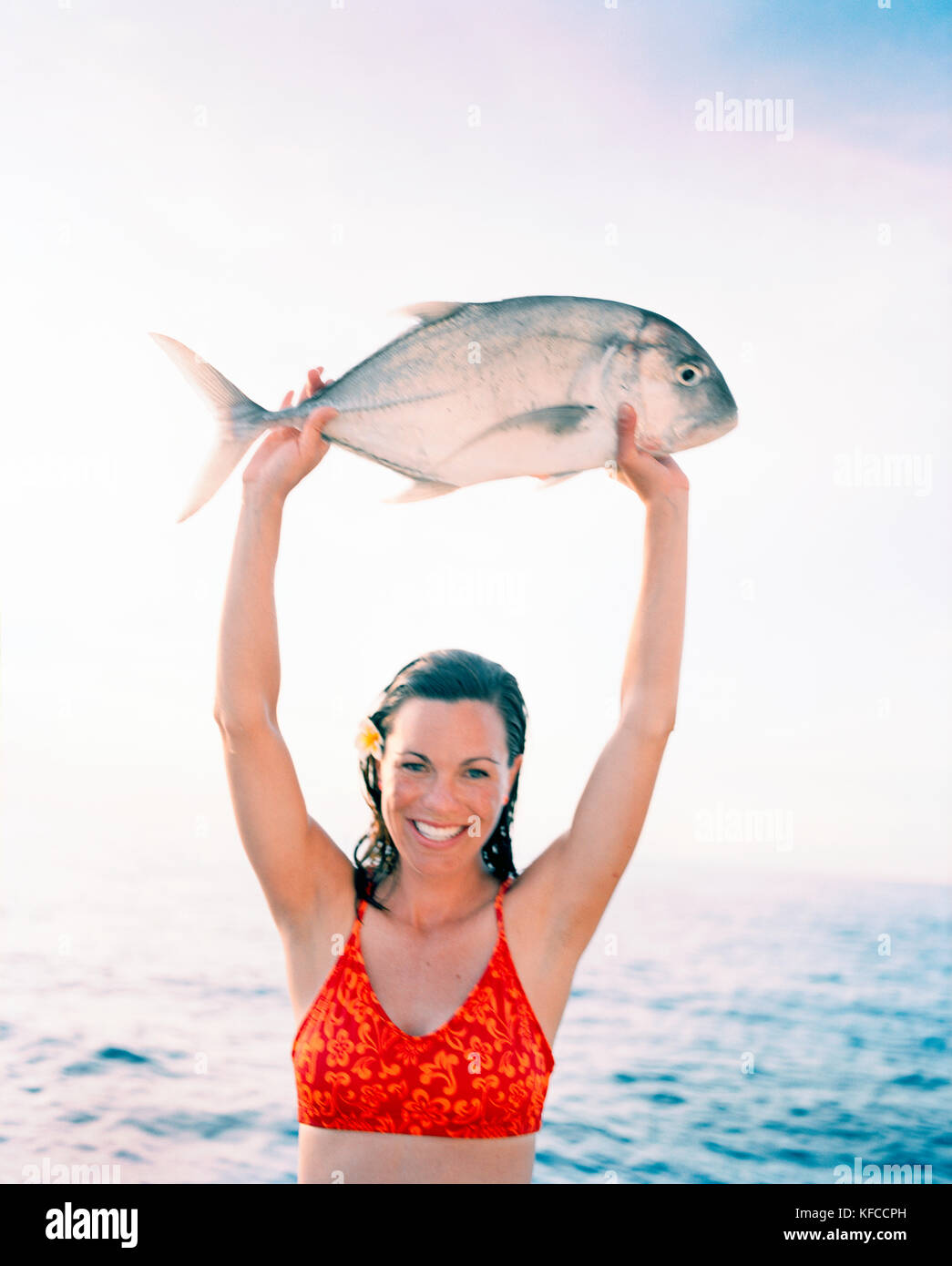 Fiji Northern Lau Islands A Smiling Young Woman Holds Up A Travail Stock Photo Alamy