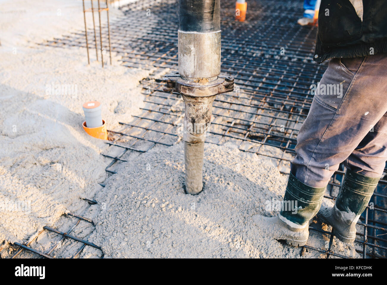 Concrete pouring during commercial concreting floors of buildings in construction site - concrete slab Stock Photo