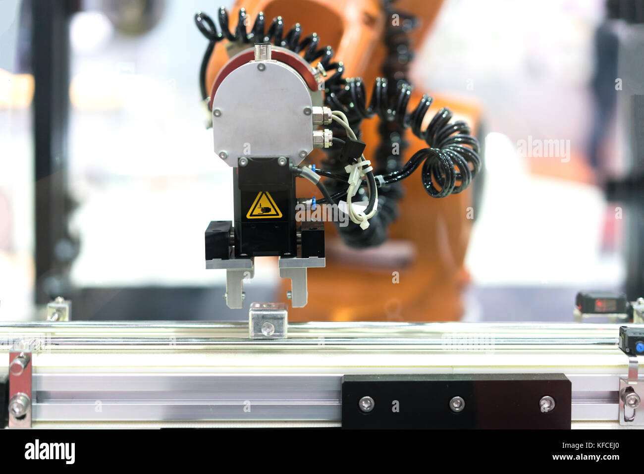 Automatic robot arm with imaging sensor in assembly line working in factory. Smart factory industry 4.0 concept. Stock Photo