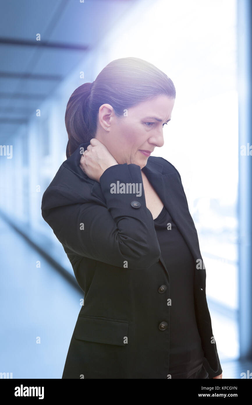 Middle aged woman with chronic pain syndrome fibromyalgia suffering from acute neckache Stock Photo