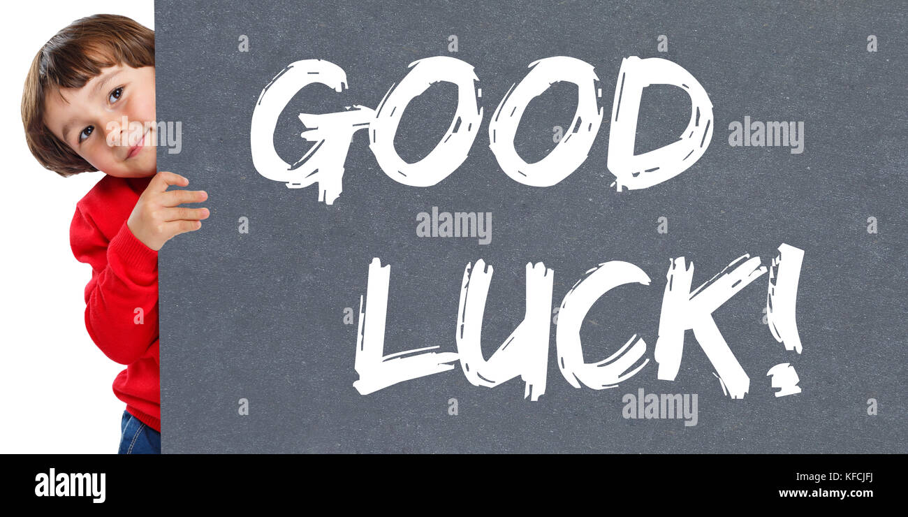 Good luck success successful test wish wishing child kid young little boy isolated on a white background - Stock Image