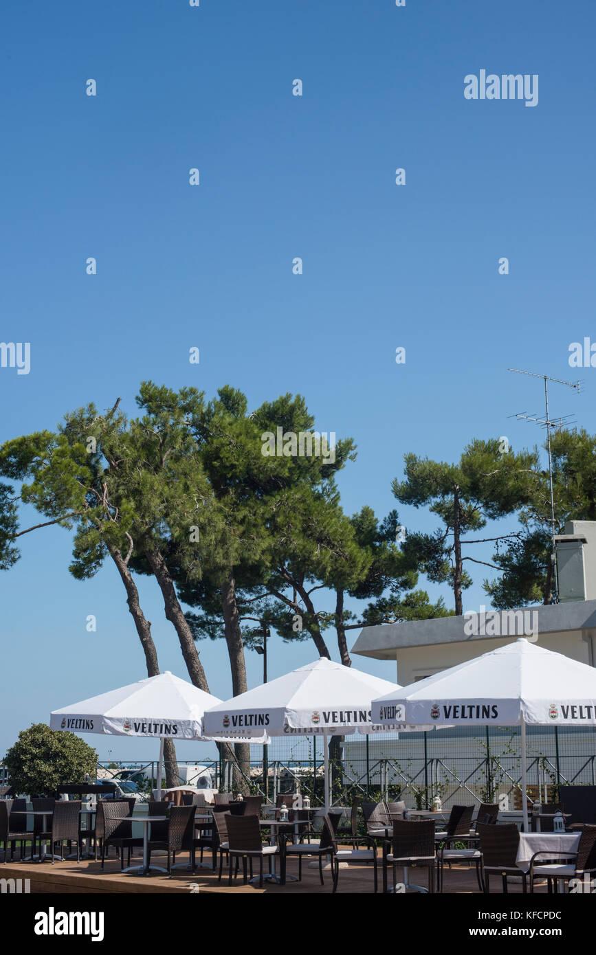 Blue sly and pine trees over the Hemmingway Restaurant, Porto Santa Margherita, Veneto - Stock Image