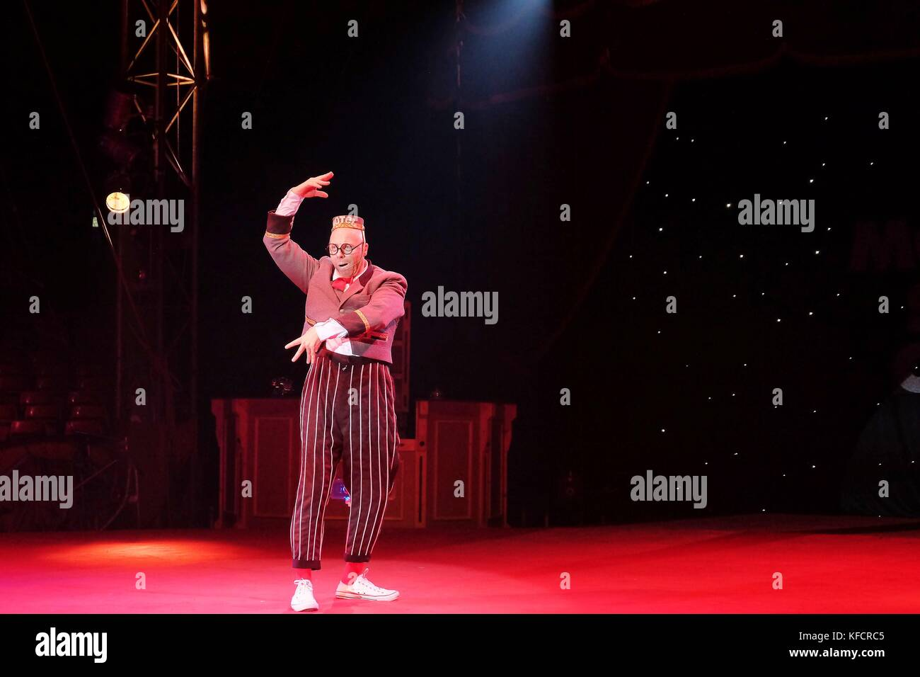 circus performers stripey trousers and hat Stock Photo