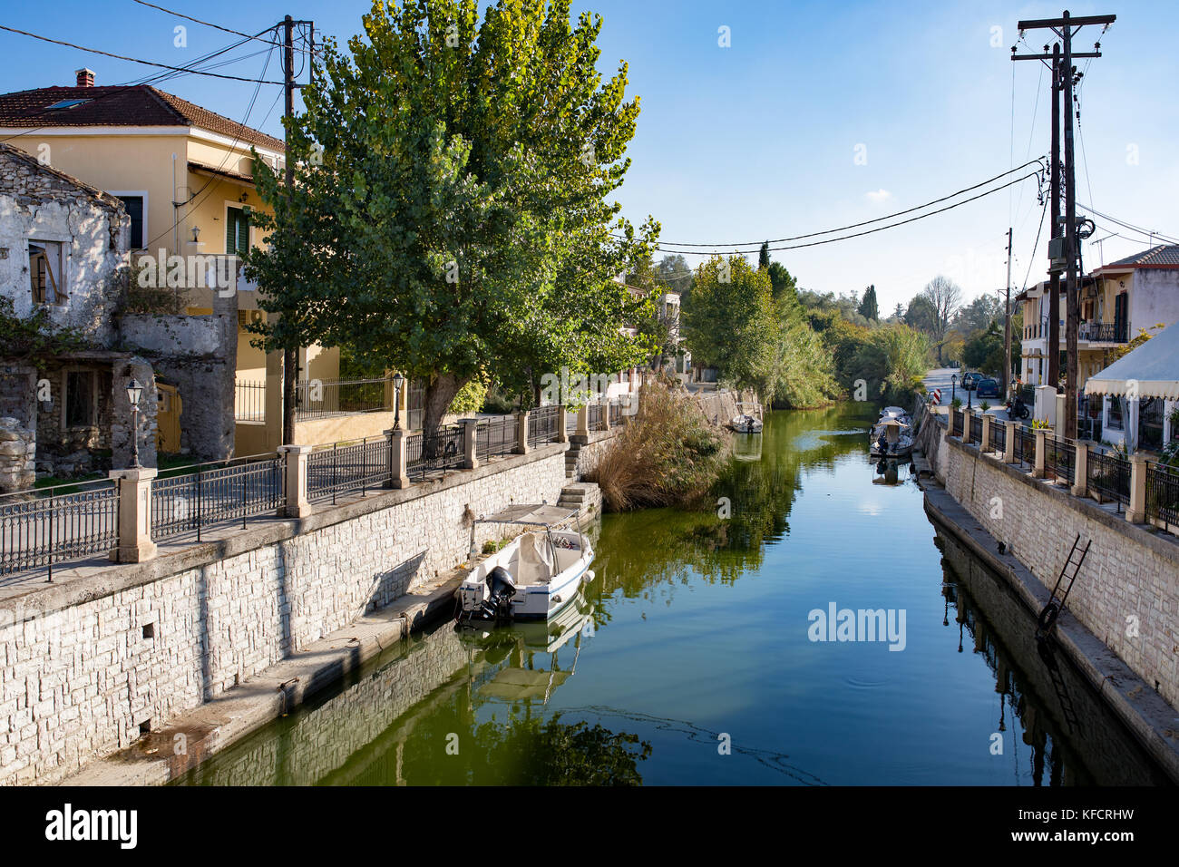 The canal or river in the greek town Lefkimmi, Ionian Islands, Corfu, Greece. Boats, restaurants, vacation in Greece. - Stock Image