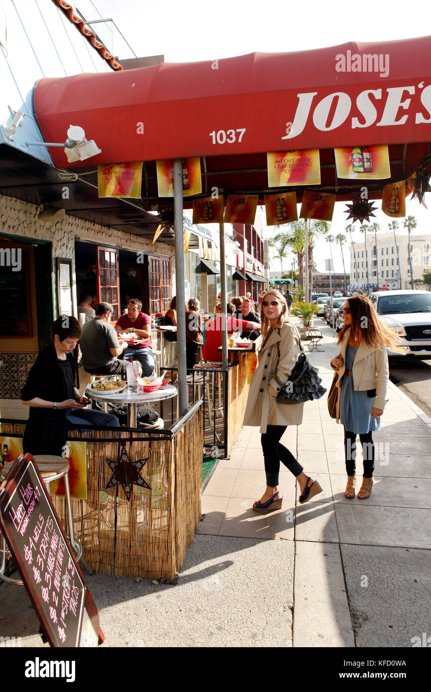 USA, California, San Diego, two women stop to look inside Jose's Restaurant in La Jolla Stock Photo