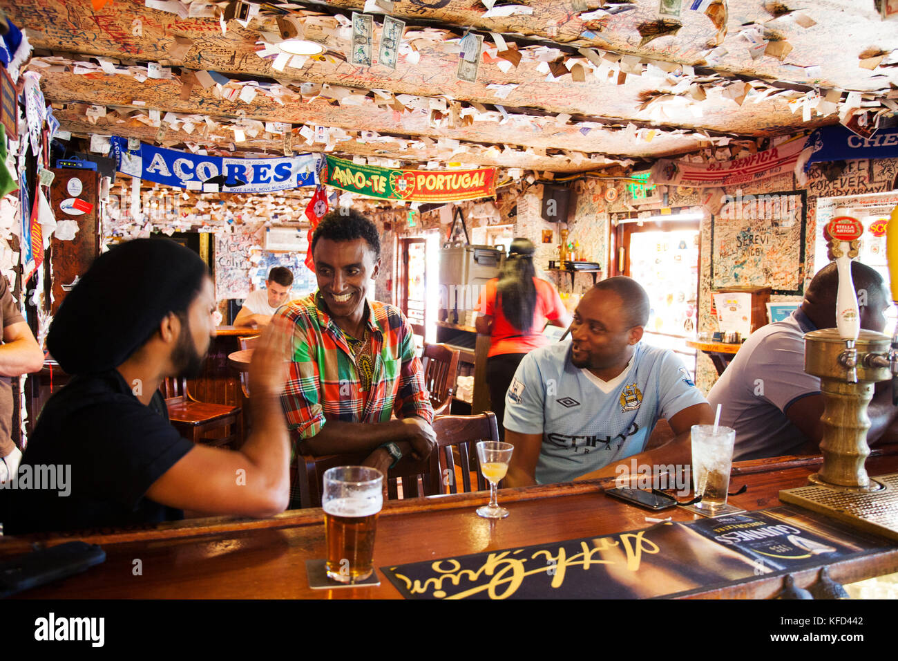 BERUMDA. Chef Marcus Samuelsson having a drink with the locals while watching a soccer game at the Swizzle Inn at Stock Photo