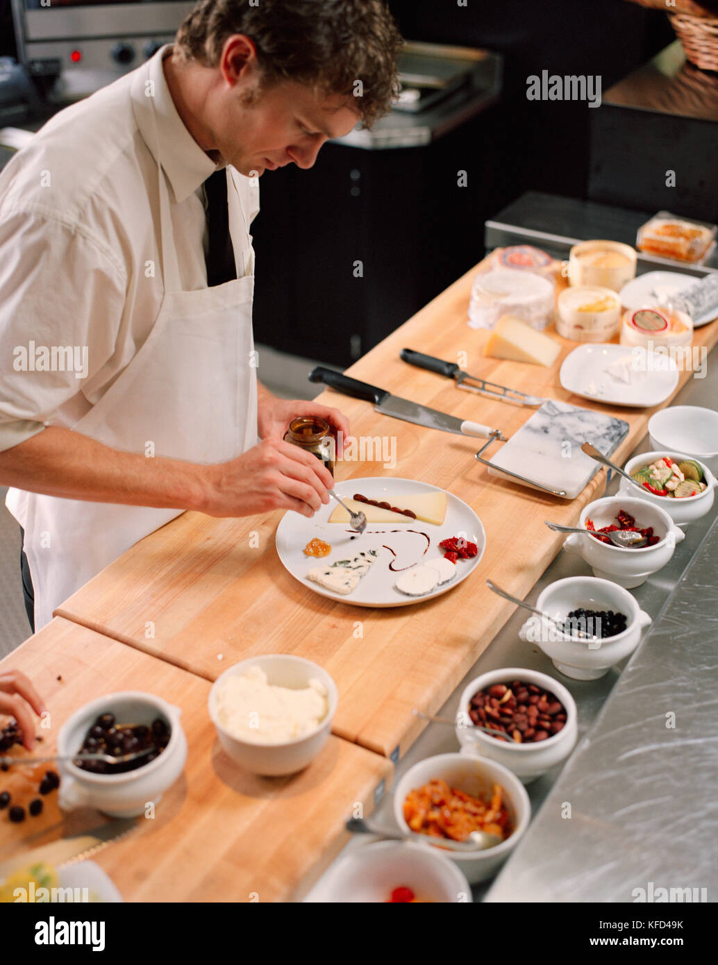 USA California Los Angeles chef decorating a cheese plate at the cheese bar of Comme Ca Restaurant.  sc 1 st  Alamy & USA California Los Angeles chef decorating a cheese plate at the ...
