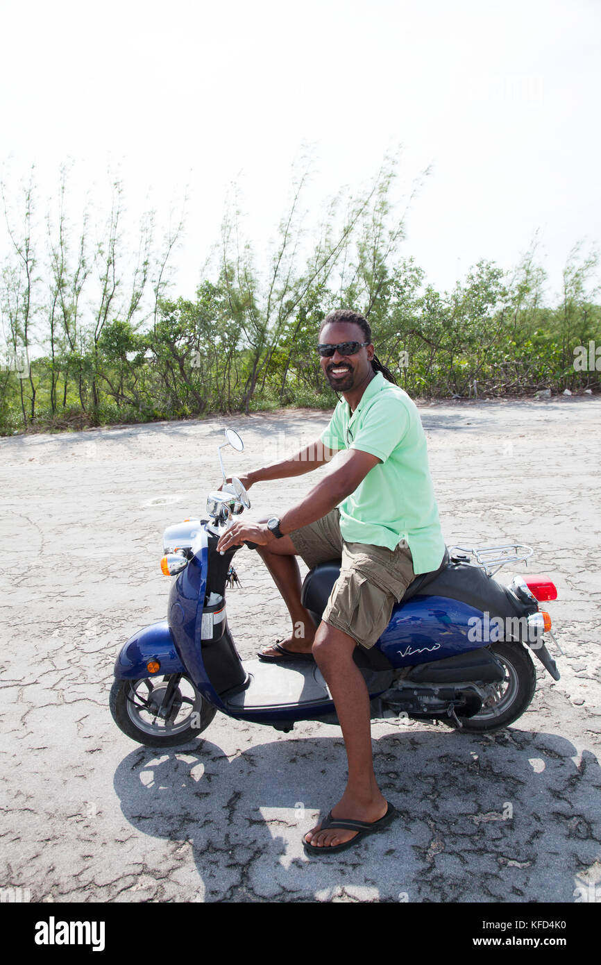 EXUMA, Bahamas  A local man on his scooter at the Staniel