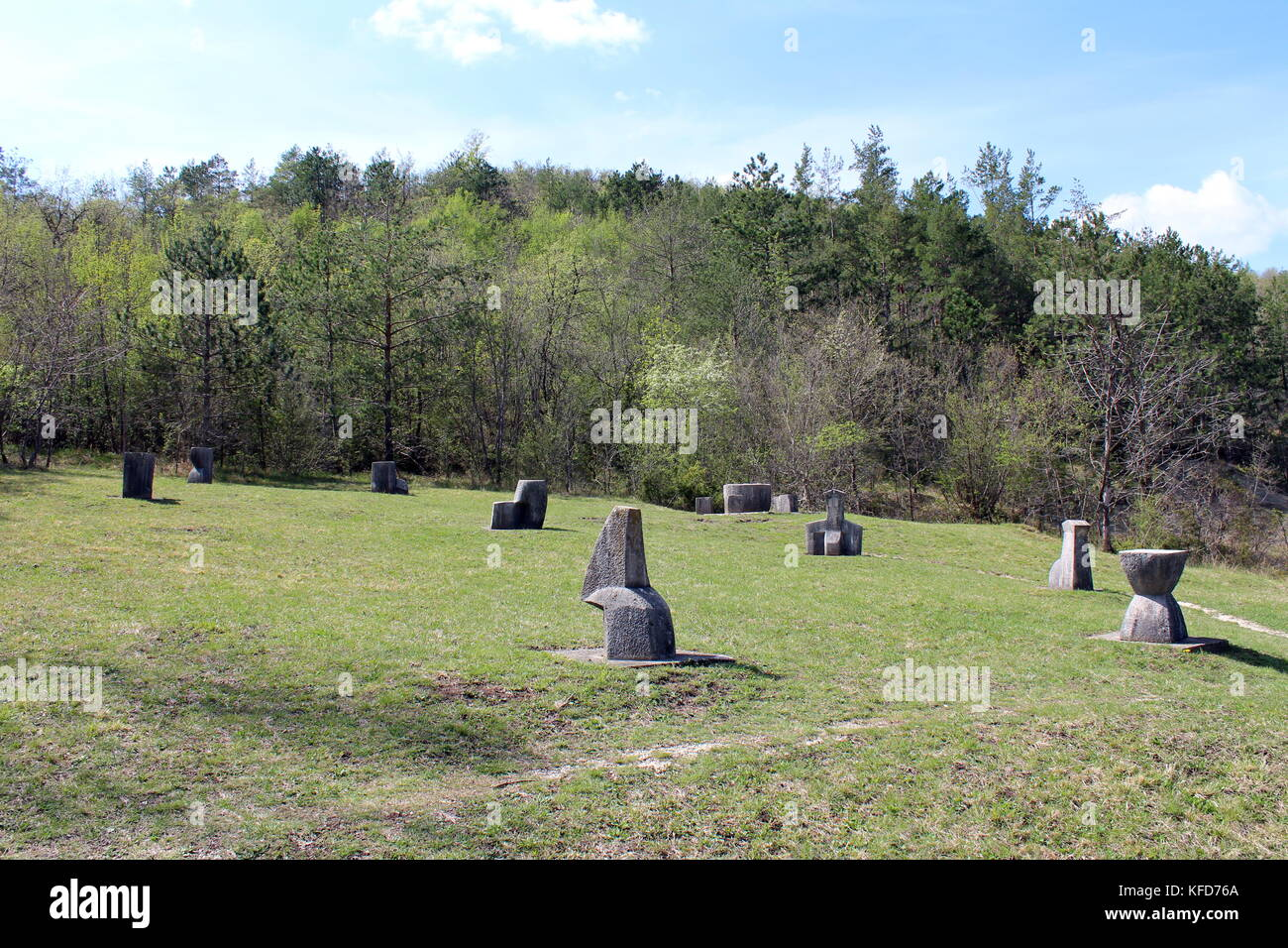 Glagolitic letters made from stone called Uspon Istarskog razvoda scattered over large grass area and surrounded - Stock Image