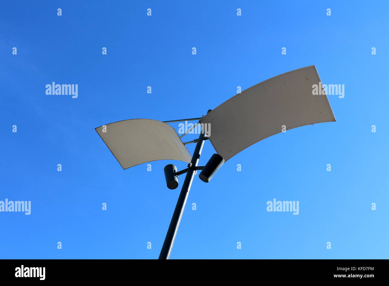 Modern LED lamp post with two reflecting panels and two LED lamps pointed at them - Stock Image