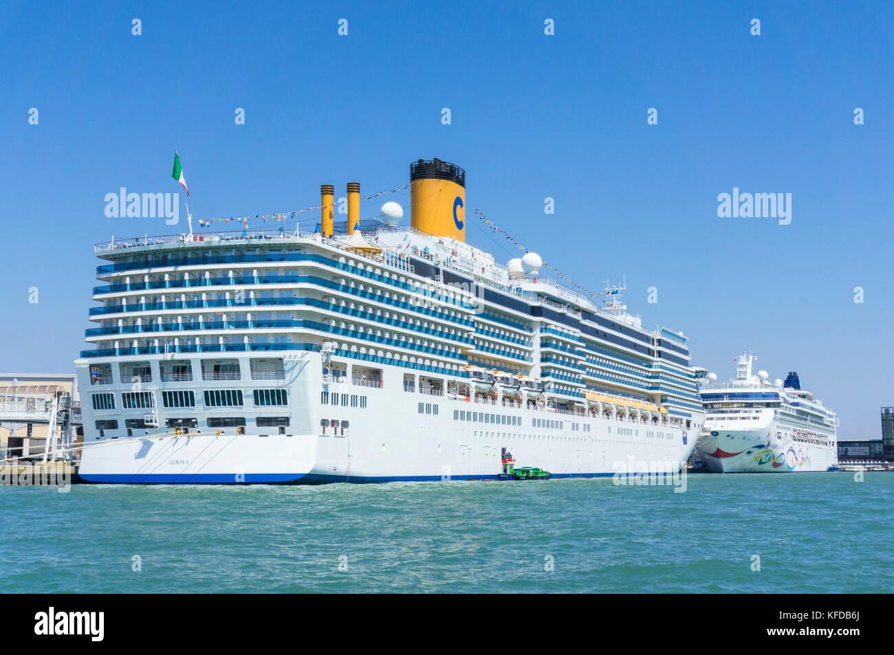 VENICE ITALY VENICE Massive Cruise ships moored in Venice Marittima ship basin or venice cruise terminal in the - Stock Image