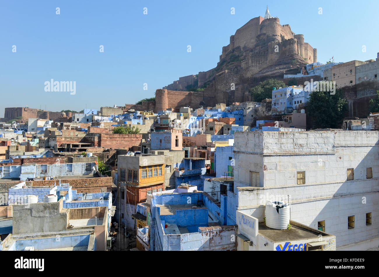 Cityscape of Jodphur with traditional indigo blue and white painted houses and the 15th century Mehrangarh Fortress on the hilltop. Stock Photo