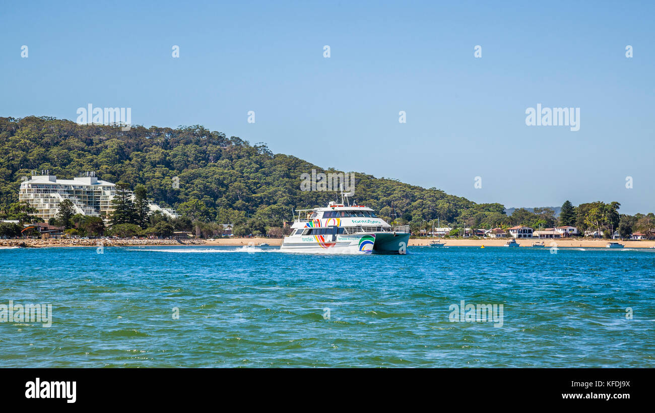 Australia, New South Wales, Central Coast, Ettalong Beach, the catamaran ferry to Palm Beach against the backdrop - Stock Image
