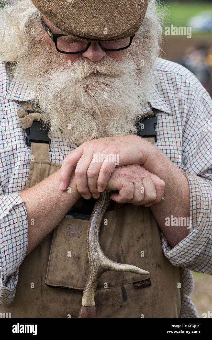Bearded farmer leaning on his crook at Weald and Downland open air museum, autumn countryside show, Singleton, Sussex, - Stock Image