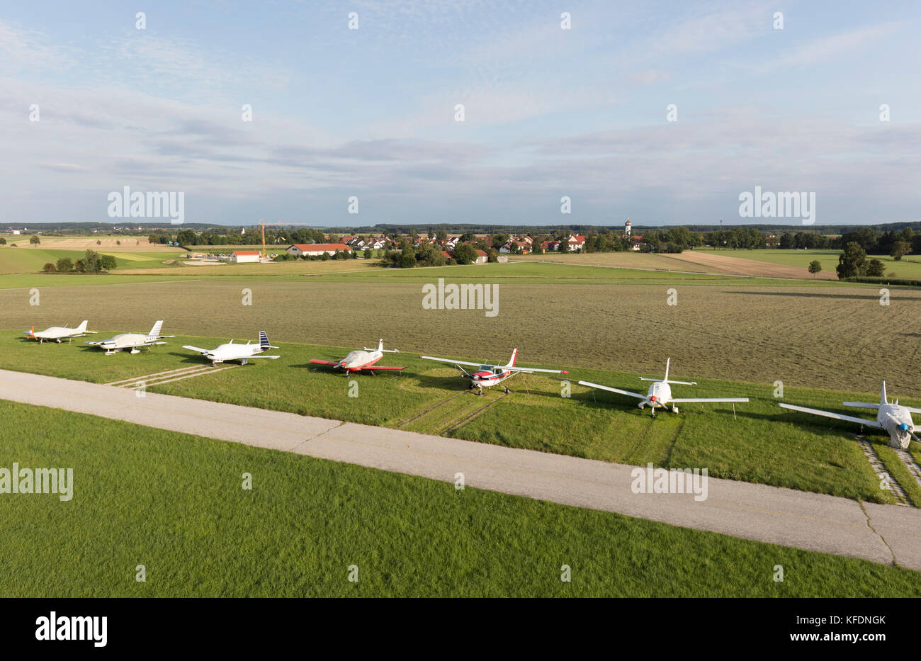 private propeller aircraft beside taxiway at Jesenwang airport, district of Fürstenfeldbruck in Bavaria in - Stock Image