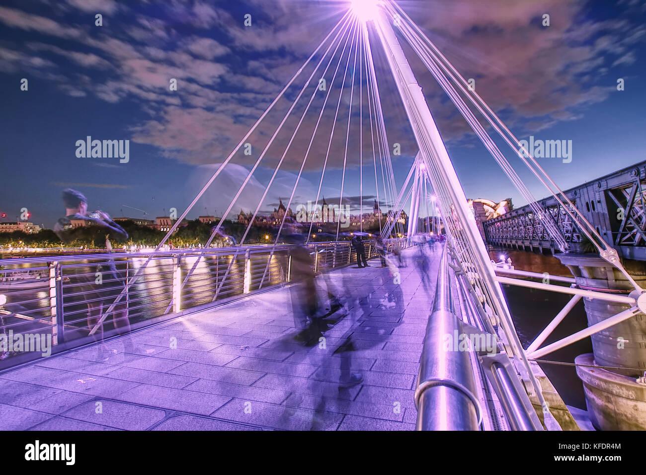 Ghosts on Jubilee Bridge at night,London,United Kingdom,summer 2017. Stock Photo