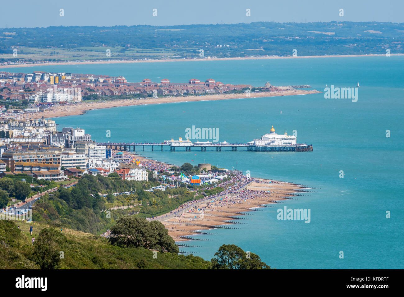 Aerial view of Eastbourne seafront, promenade, pier and English Channel from Beachy Head cliff top footpath Stock Photo