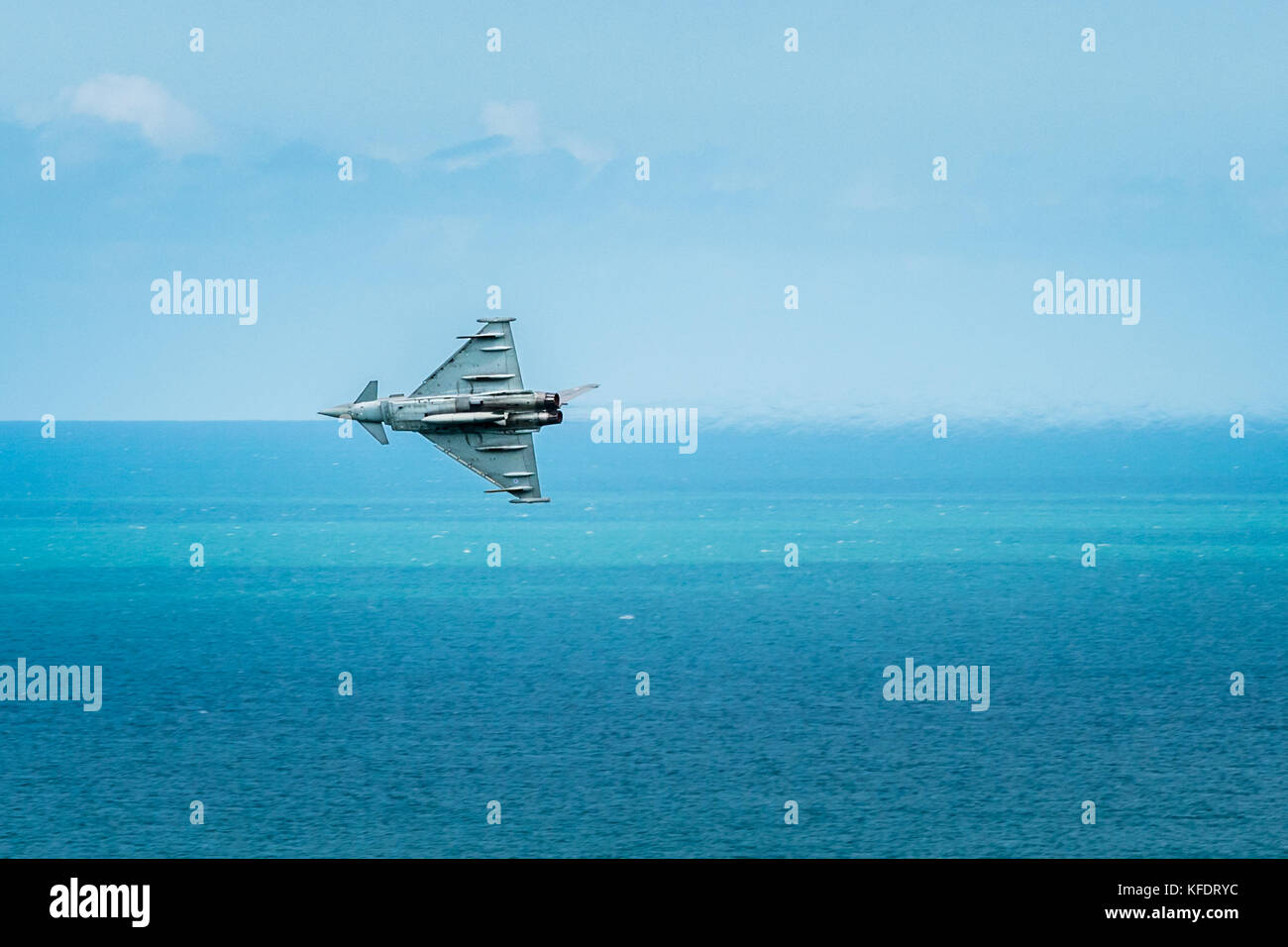 Eurofighter Typhoon Jet flies along horizon above English Channel sea at Eastbourne airshow.display - Stock Image