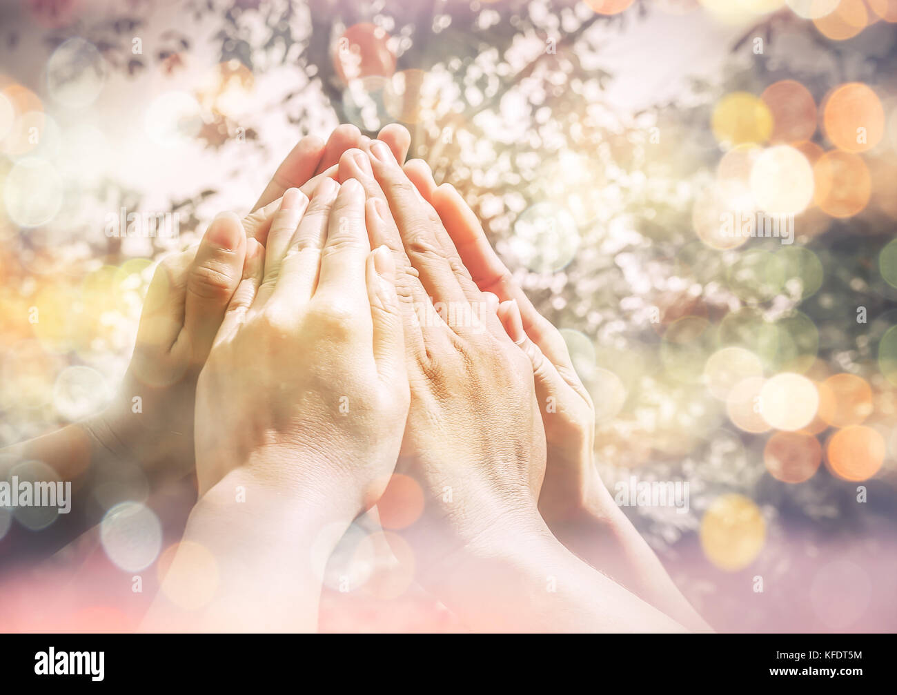 Group of diverse multi ethnic together People make high hands ,Teamwork Concept,business teamwork - Stock Image