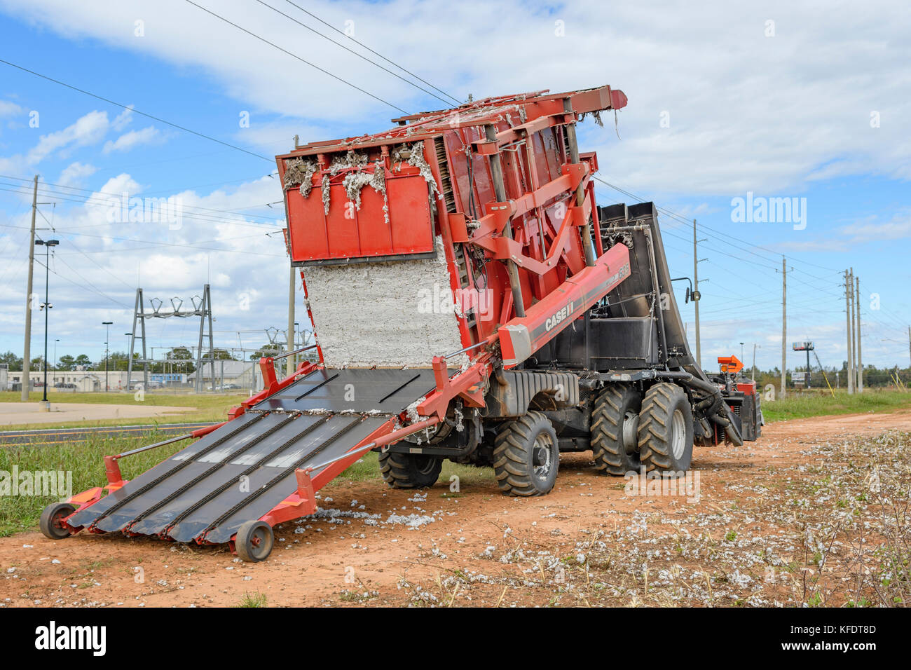 Case IH Module Express 635 tilting back to empty its receiving bay of freshly picked cotton on a cotton farm in - Stock Image