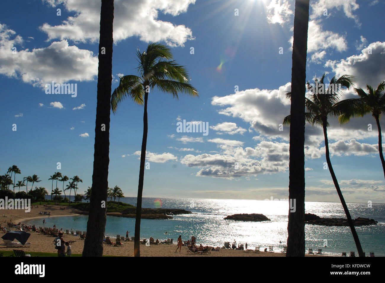 Sunshine glistens on the water of Ko Olina Resort on the island of Oahu, Hawaii - Stock Image