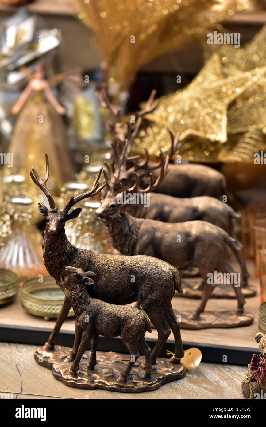 Wooden reindeer ornaments or christmas tree decorations with a golden Star of David in the background. Yuletide - Stock Image