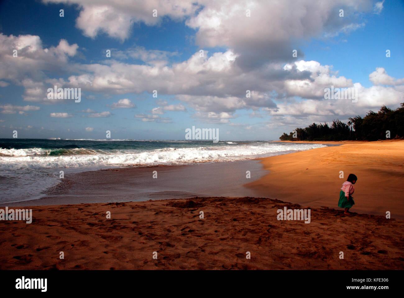 Young girl explores Haena Beach on the island of Kauai, Hawaii - Stock Image