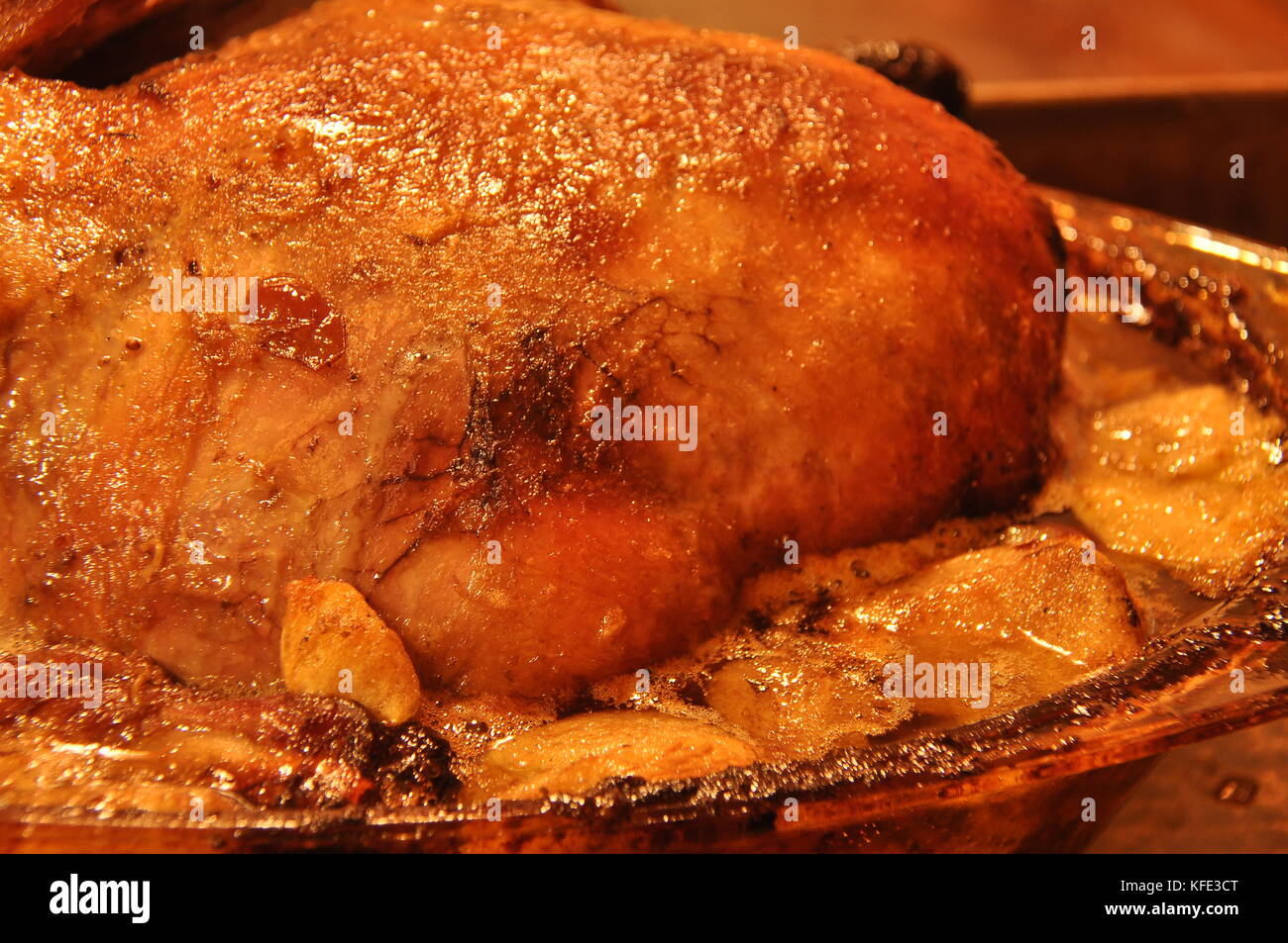 Duck with apples and cranberries. Poultry baked in casserole. - Stock Image