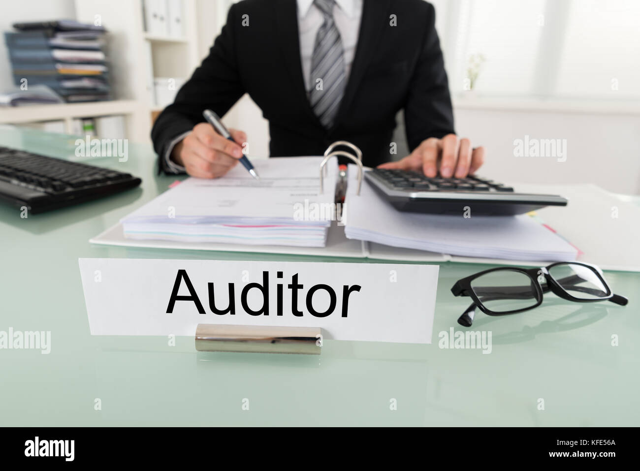Photo Of Male Auditor Calculating Bill In Office - Stock Image