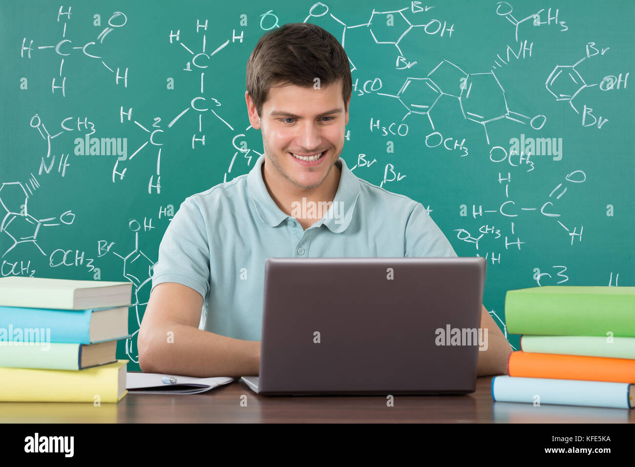 Young Happy Man Using Laptop While Studying In Classroom - Stock Image