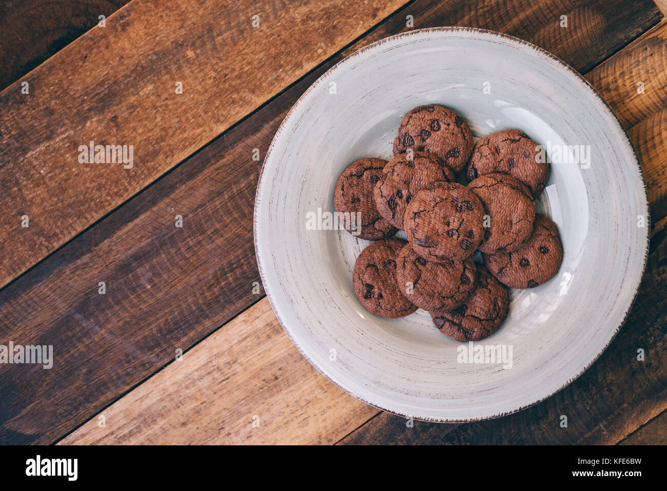 cookies in a plate on a wooden table Stock Photo