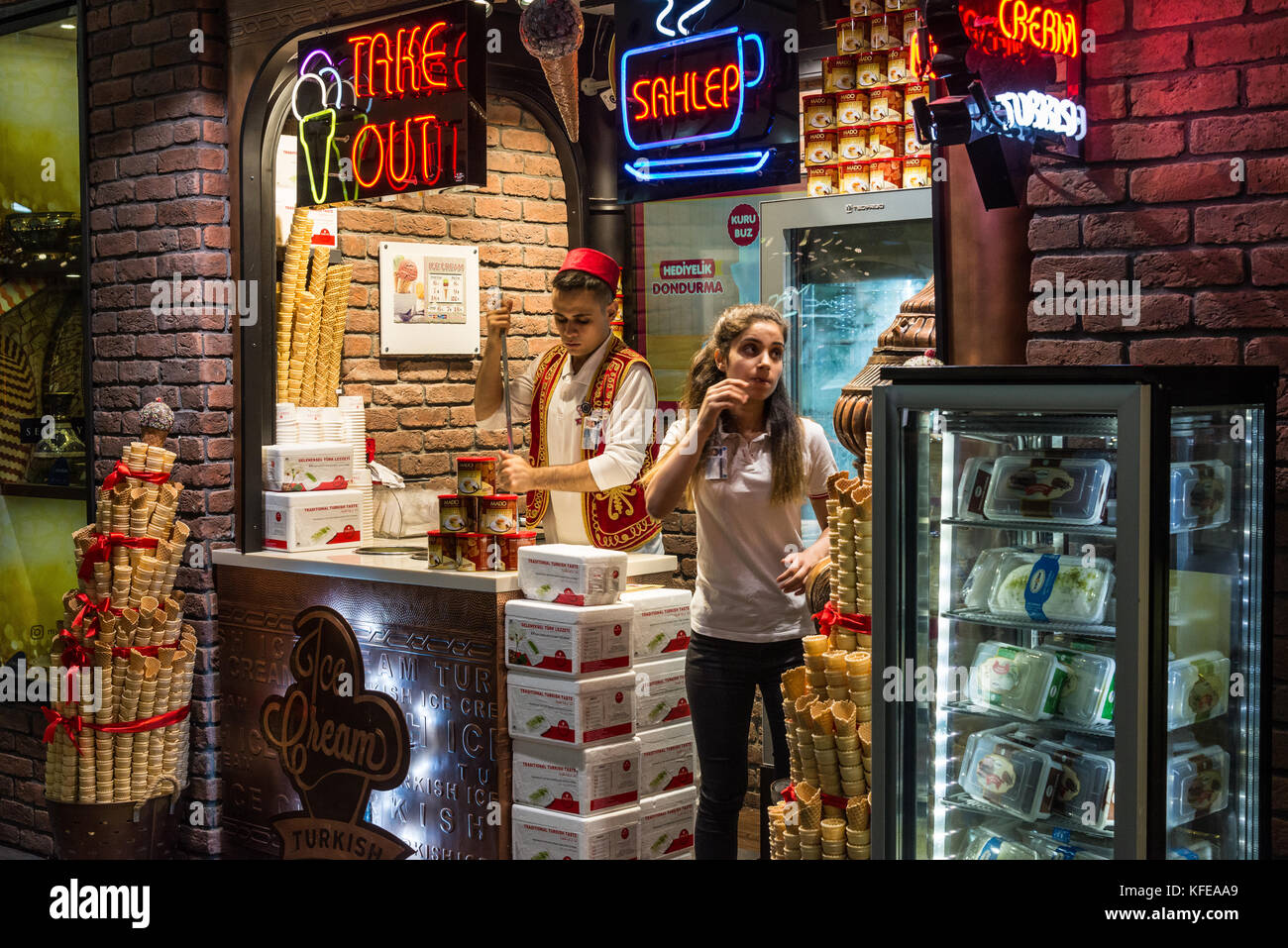 A young man and woman working in a traditional Turkish ice-cream shop. Istanbul, Turkey. - Stock Image