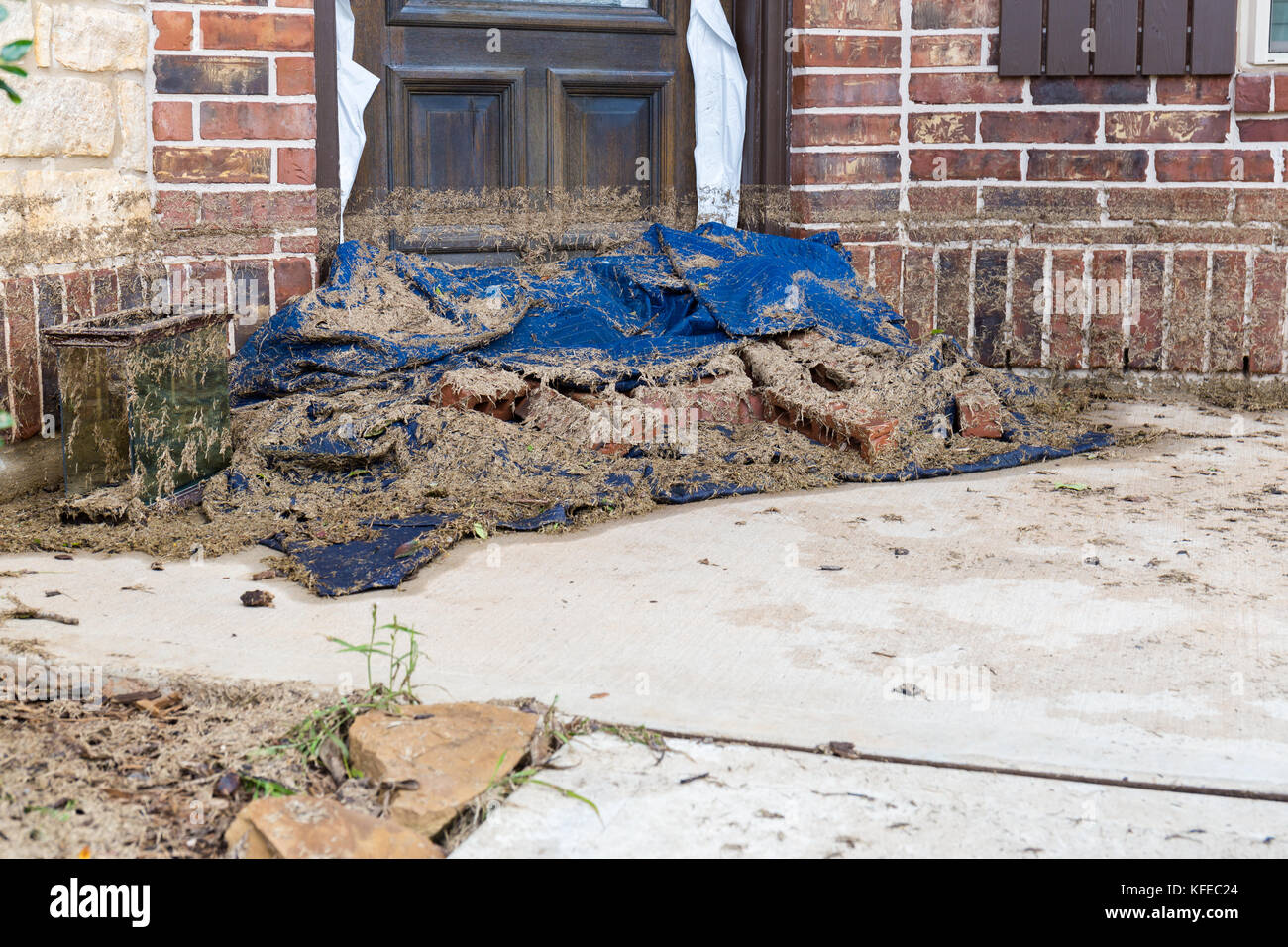 Hurricanes like Harvey cause catastrophic flooding in residential areas. The high water and sediment sludge mark - Stock Image