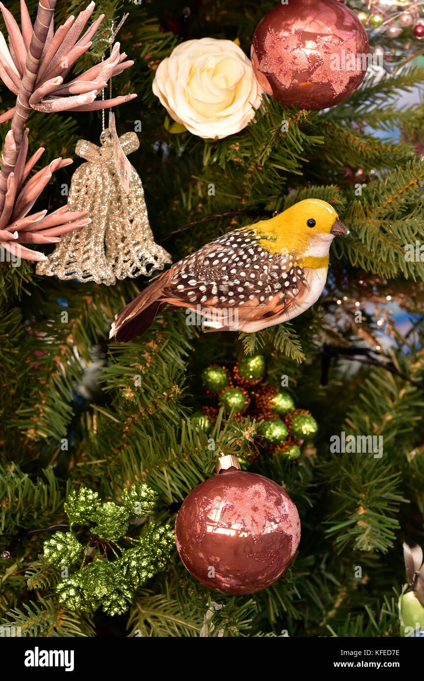 A Small Yellow Bird Christmas Tree Decoration Among Baubles Bells And Stock Photo Alamy