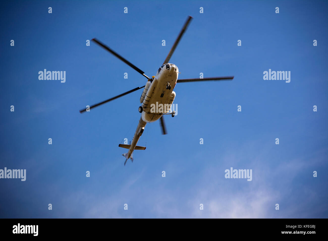 Passenger russian helicopter MI-8 fly in sky. - Stock Image